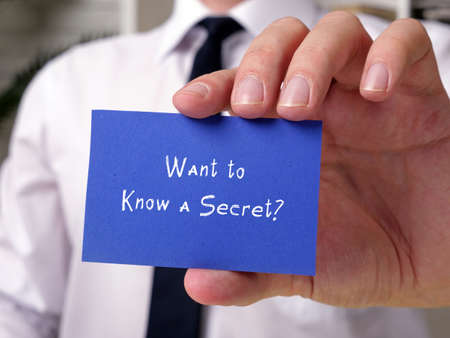 Business concept meaning Want to Know a Secret? with phrase on the piece of paper.