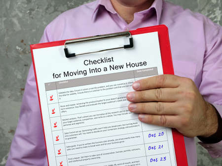 Business concept about Checklist for Moving Into a New House with phrase on the sheet.