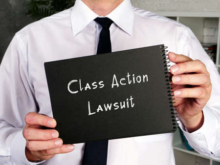 Class Action Lawsuit sign on the piece of paper.
