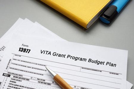 Form 13977 VITA Grant Program Budget Plan phrase on the piece of paper. Standard-Bild