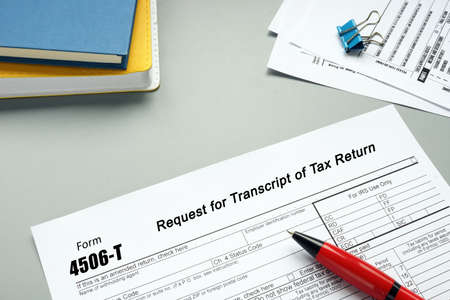 Financial concept about Form 4506-T Request for Transcript of Tax Return with inscription on the page.