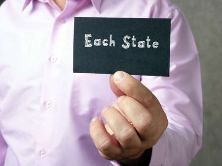 Business concept meaning Each State with sign on the sheet.