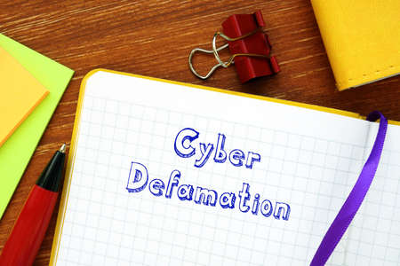 Conceptual photo about Cyber Defamation with written text.