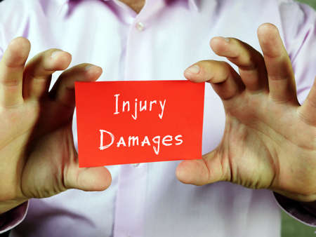 Business concept about Injury Damages with inscription on the sheet.