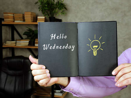 Business concept meaning Hello Wednesday with sign on the page. Фото со стока
