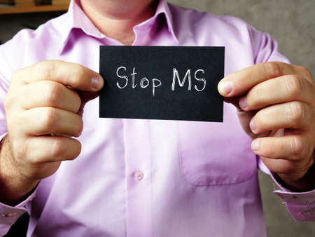 Financial concept about Stop MS with phrase on the piece of paper.