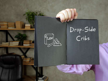 Conceptual photo about Drop-Side Cribs with written text. Reklamní fotografie