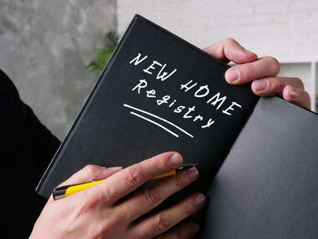 Financial concept about NEW HOME Registry with sign on the page.