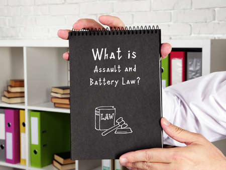 Business concept meaning Assault and Battery Law? with phrase on the piece of paper. Reklamní fotografie