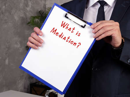 Business concept meaning Mediation? with phrase on the piece of paper. Reklamní fotografie