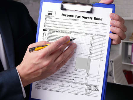 Business concept about Form 1117 Income Tax Surety Bond with phrase on the piece of paper.