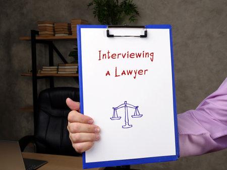 Interviewing a Lawyer phrase on the page. Zdjęcie Seryjne