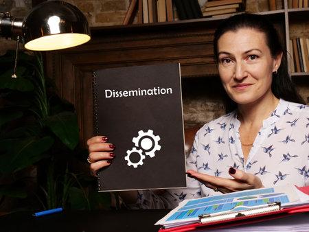 Dissemination inscription on black notepad.
