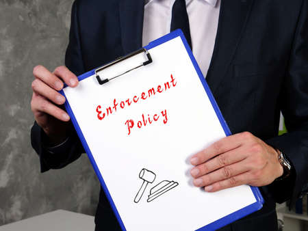 Juridical concept meaning Enforcement Policy with sign on the sheet.