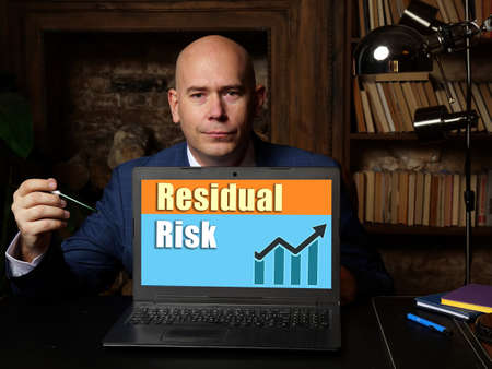 Business concept meaning Residual Risk with phrase on laptop.