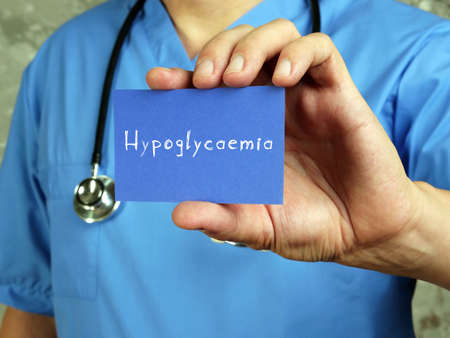 Medical concept meaning Hypoglycaemia low blood sugar with sign on the page.