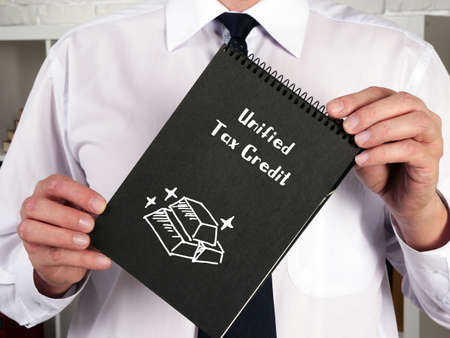 Business concept meaning Unified Tax Credit with inscription on the sheet.