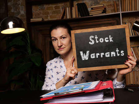 Hand holding chalkboard with phrase Stock Warrants . Reklamní fotografie
