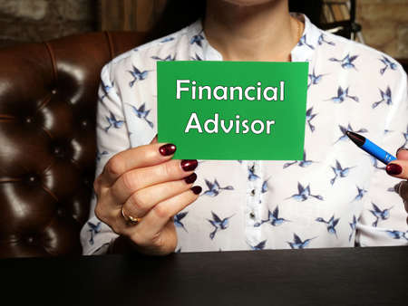 Conceptual photo about Financial Advisor with written text green business card.