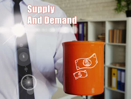 Business concept meaning Supply And Demand Man with a cup of coffee in the background.