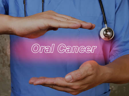 Medical concept about Oral Cancer with phrase on the piece of paper.