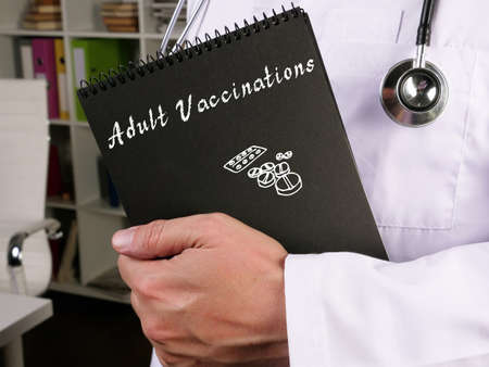 Conceptual photo about Adult Vaccinations with handwritten phrase. Zdjęcie Seryjne