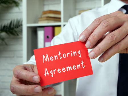 Business concept meaning Mentoring Agreement with sign on the piece of paper. Zdjęcie Seryjne