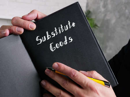 Business concept meaning Substitute Goods with sign on the piece of paper.