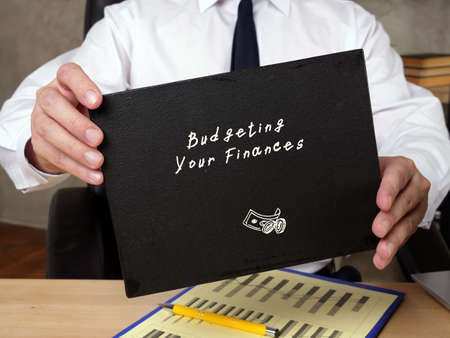 Business concept about Budgeting Your Finances r with phrase on the sheet.