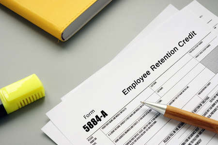 Financial concept about Form 5884-A Employee Retention Credit with inscription on the page.