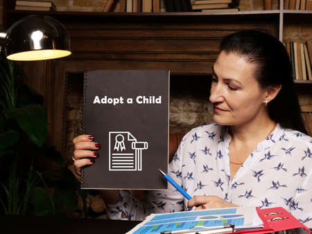 Conceptual photo about Adopt a Child with handwritten text.