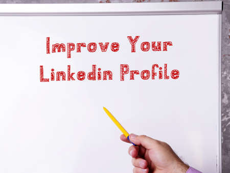 Motivational concept meaning Improve Your Linkedin Profile with phrase on the piece of paper.