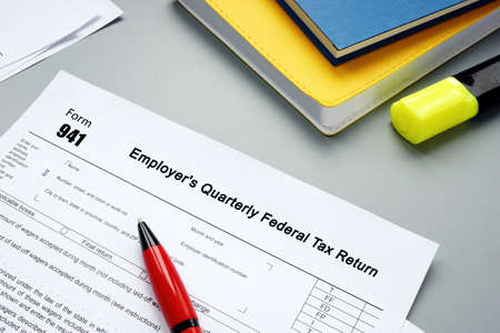 Form 941 Employer's Quarterly Federal Tax Return inscription on the sheet.