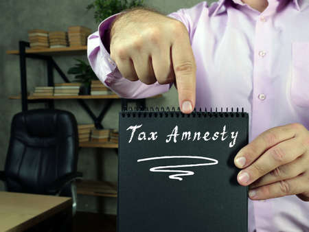 Juridical concept meaning Tax Amnesty with phrase on the piece of paper.