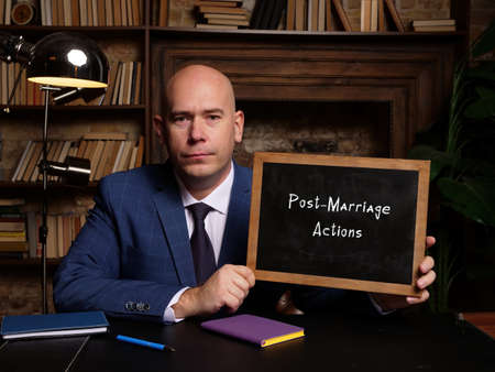 Conceptual photo about Post-Marriage Actions with written text on the chalkboard.