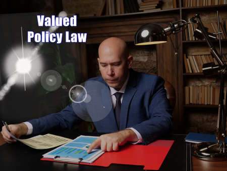 Business concept about Valued Policy Law. Closeup portrait of unrecognizable successful businessman wearing formal suit reading documents