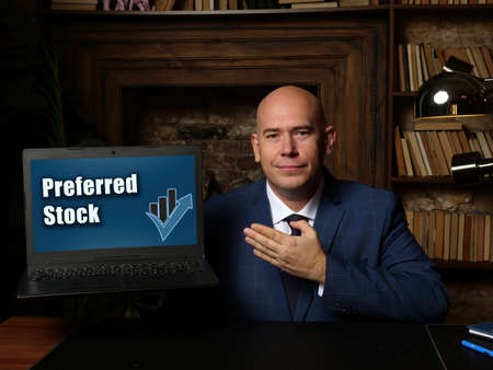Business concept about Preferred Stock with sign on laptop in hand.