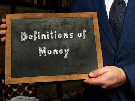 Business concept meaning Definitions of Money with sign on the black chalkboard.