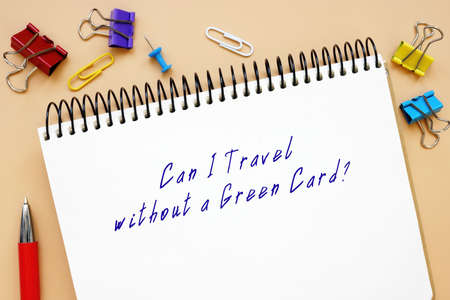 Can I Travel without a Green Card? phrase on the sheet. Stock Photo