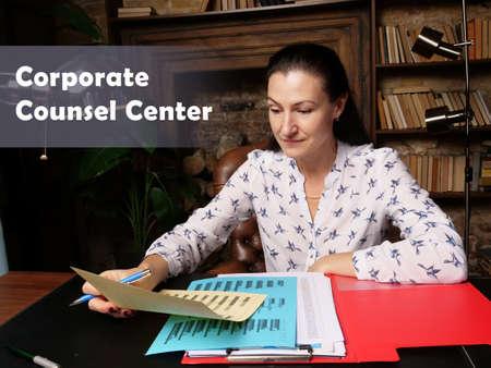 Business concept about Corporate Counsel Center. Closeup portrait of unrecognizable successful Businesswoman wearing formal suit reading documents