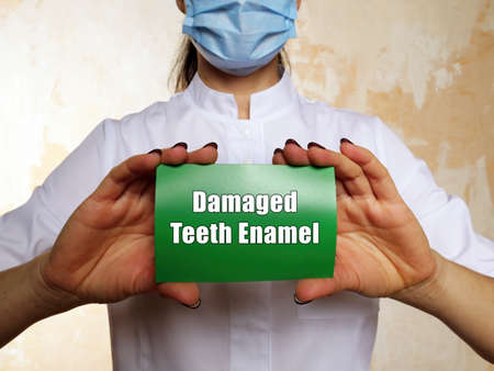 Medical concept about Damaged Teeth Enamel with phrase on the piece of paper.