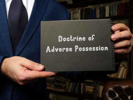 Legal concept about Doctrine of Adverse Possession with inscription on the sheet.