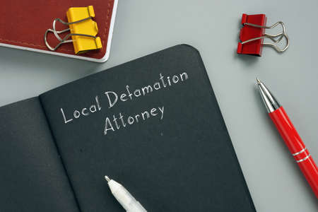Juridical concept about Local Defamation Attorney with sign on the page. Stok Fotoğraf