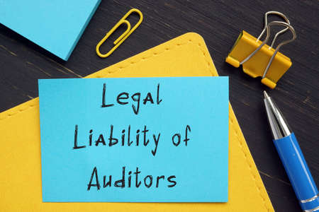 Financial concept about Legal Liability of Auditors with sign on the sheet.