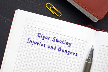 Juridical concept about Cigar Smoking Injuries and Dangers with phrase on the sheet.