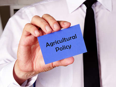 Financial concept meaning Agricultural Policy with inscription on the piece of paper.