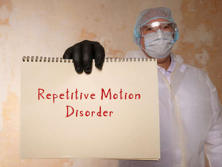 Repetitive Motion Disorder sign on the piece of paper. Imagens