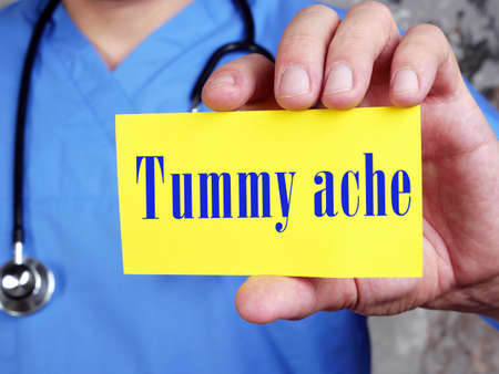Health care concept about Tummy ache with sign on the page. Archivio Fotografico