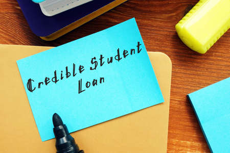 Financial concept about Credible Student Loan with inscription on the sheet.