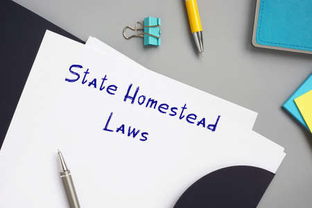 Legal concept meaning State Homestead Laws with sign on the piece of paper.